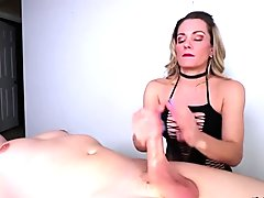 Mature dom jerks off her slave