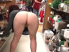 Flashing and spreading ass in very public store